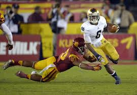 Running back Theo Riddick helped Notre Dame beat USC 22-13 to claim a spot in the BCS National Championship game.